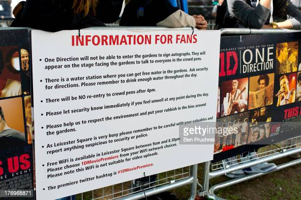 General view of posters as One Direction Fans camp in Leicester Square ahead of the bands London Premiere for 'This Is Us' on August 19 2013 in...
