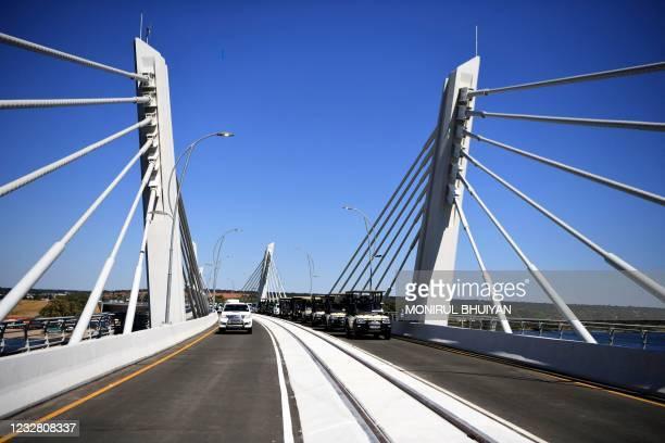 General view of presidential convoy crossing the Kazungula bridge on the Zambezi river in Kazungula, Botswana, on May 10, 2021. - A new road and rail...
