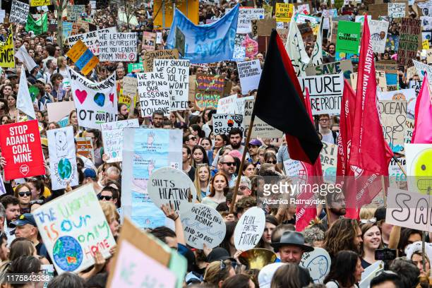 A general view of protestors holding placards as they march on September 20 2019 in Melbourne Australia Rallies held across Australia are part of a...