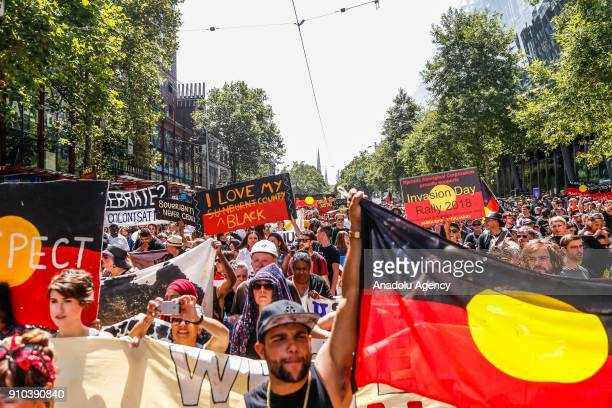 General view of protestors marching holding placards and shouting chants during a protest by Aboriginal rights activist on Australia Day in...