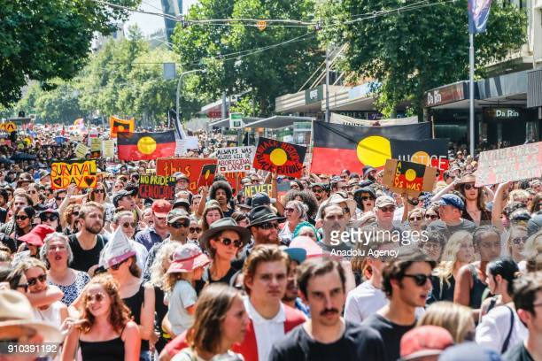A general view of protestors marching holding placards and shouting chants during a protest by Aboriginal rights activist on Australia Day in...