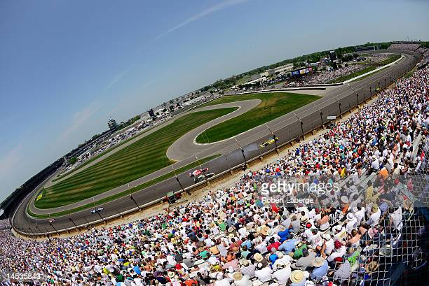 A general view of race action as Ana Beatriz of Brazil driver of the Team Ipiranga Chevrolet spins out during the IZOD IndyCar Series 96th running of...