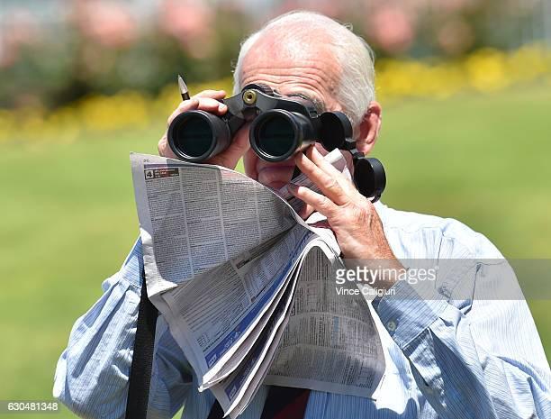 General view of racegoer looking through binoculars during Ladbrokes Park Race Day at Sandown Racecourse on December 24 2016 in Melbourne Australia