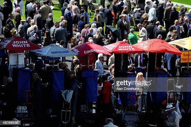 A general view of racegoers around the bookmakers area at Goodwood racecourse on May 22 2014 in Chichester England
