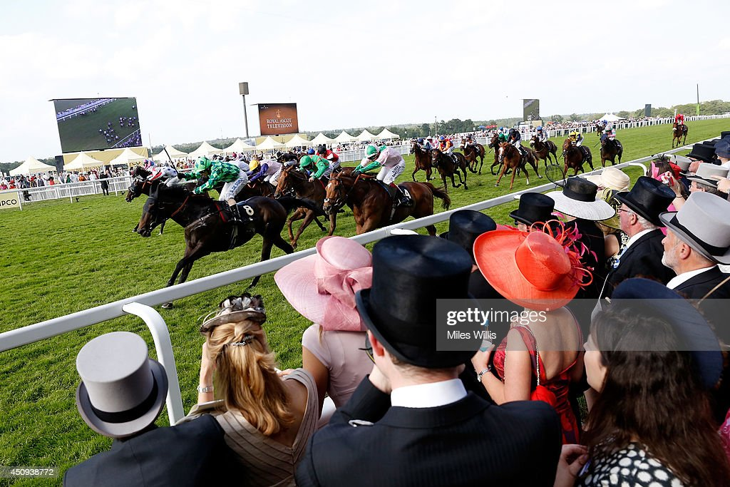 A general view of racegoers watching the riders during day four of Royal Ascot 2014 at Ascot Racecourse on June 20, 2014 in Ascot, England.
