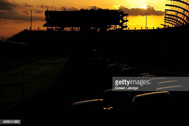 General view of racing at sunset during the NASCAR Nationwide Series Ford EcoBoost 300 at Homestead-Miami Speedway on November 15, 2014 in Homestead,...