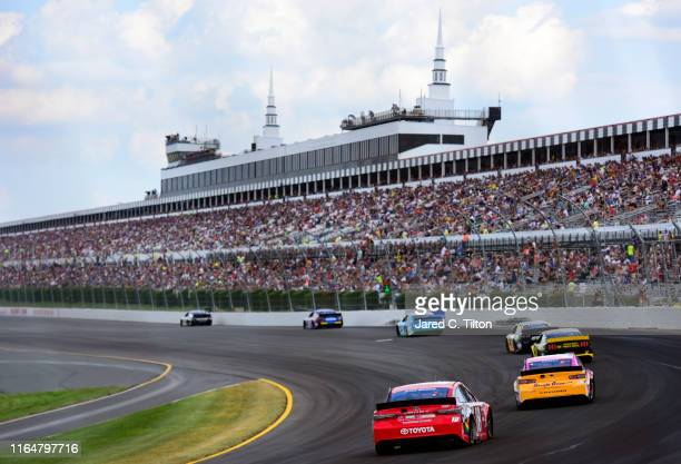 A general view of racing during the Monster Energy NASCAR Cup Series Gander RV 400 at Pocono Raceway on July 28 2019 in Long Pond Pennsylvania