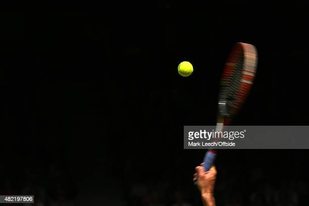 A general view of racket and ball as Ivo Karlovic serves on day seven of the Wimbledon Lawn Tennis Championships at the All England Lawn Tennis and...