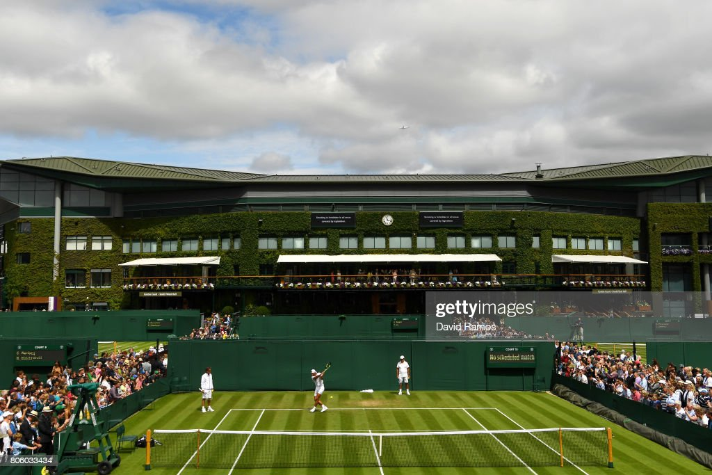 A general view of Rafael Nadal of Spain plays a backhand as coach Toni Nadal looks on during a practice session on day one of the Wimbledon Lawn Tennis Championships at the All England Lawn Tennis and Croquet Club on July 3, 2017 in London, England.