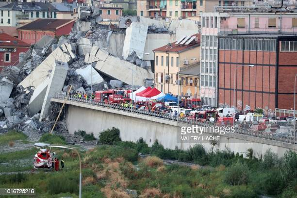 A general view of rescuers at the scene of the collapsed Morandi motorway bridge in the northwestern city of Genoa on August 14 2018 About 30 people...