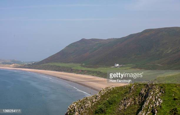 General view of Rhossili Bay beach on the Gower on August 11, 2020 in Rhossili, Wales, United Kingdom. Rhossili Beach is considered to be in the top...