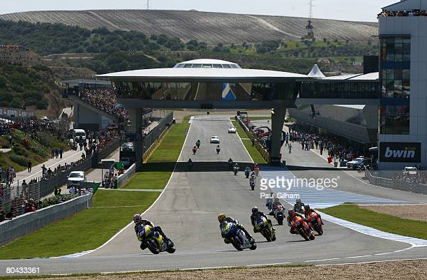 A general view of riders in action on the parade lap prior to the start of the MotoGP of Spain at Circuito de Jerez on March 30 2008 in Jerez Spain