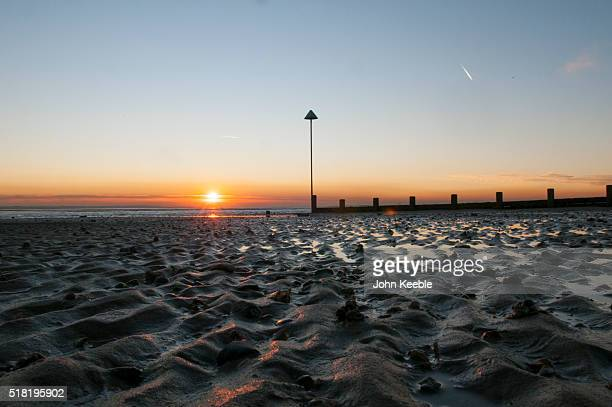 A general view of ripples on the beach as the tide goes out as sunsets over the Thames Estuary on January 19 2016 in Southend on Sea England