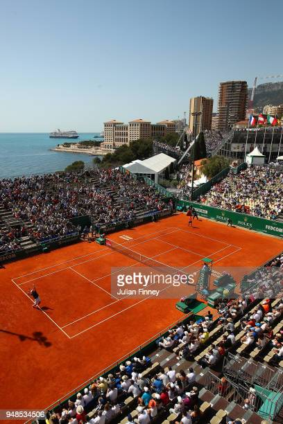 A general view of Roberto Bautista Agut of Spain serving to David Goffin of Belgium during his men's singles match on day five of the Rolex...