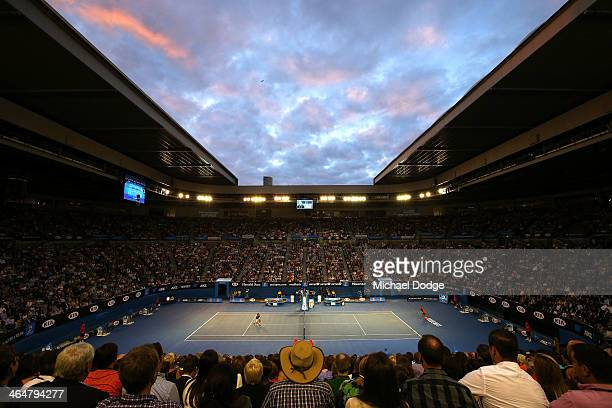 A general view of Rod Laver Arena as Roger Federer of Switzerland plays a forehand in his semifinal match against Rafael Nadal of Spain during day 12...