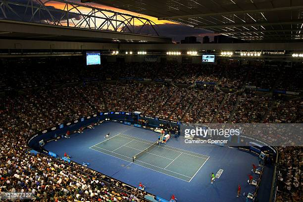 A general view of Rod Laver Arena as the sun sets as Rafael Nadal of Spain plays in his men's final match against Novak Djokovic of Serbia during day...