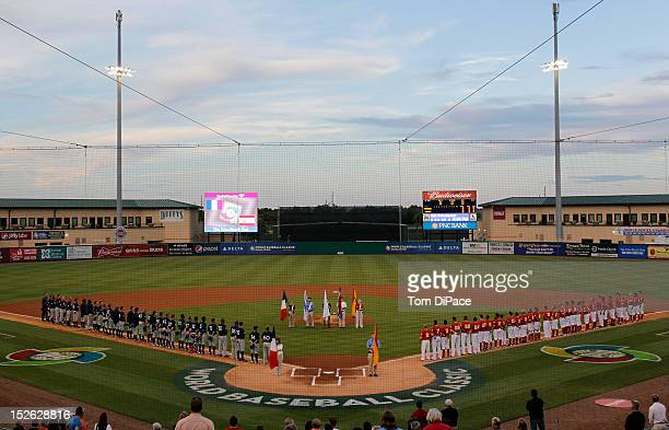 General view of Roger Dean Stadium as the players line the base paths during the opening ceremony before game 2 of the Qualifying Round of the 2013...