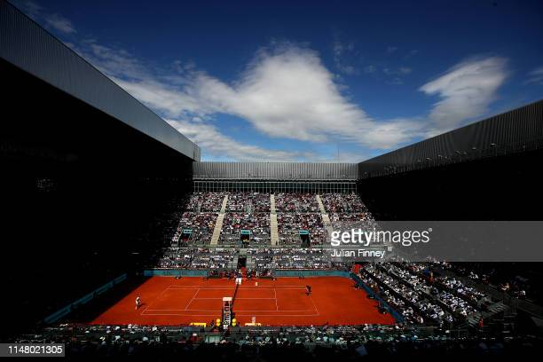 A general view of Roger Federer of Switzerland in action against Gael Monfils of France during day six of the Mutua Madrid Open at La Caja Magica on...