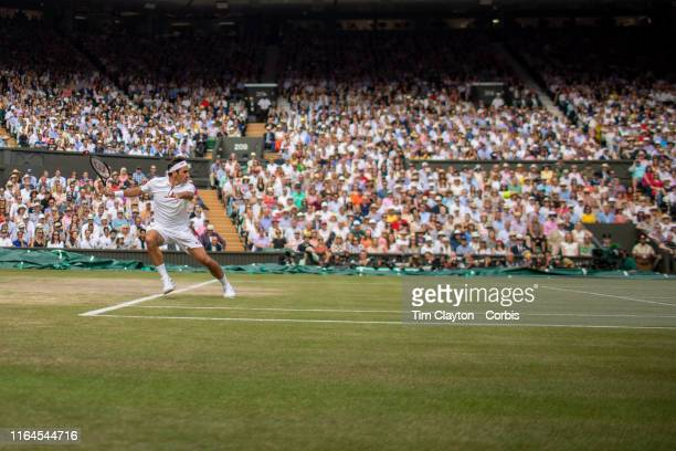 A general view of Roger Federer of Switzerland in action against Novak Djokovic of Serbia during the Men's Singles Final on Centre Court during the...