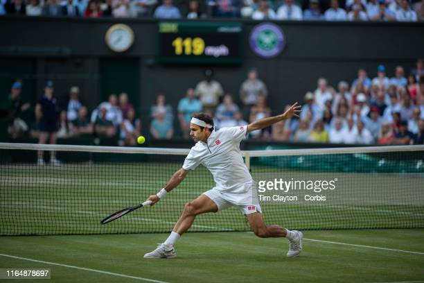 July 12: A general view of Roger Federer of Switzerland playing a volley at the net during his match against Rafael Nadal of Spain during the Men's...