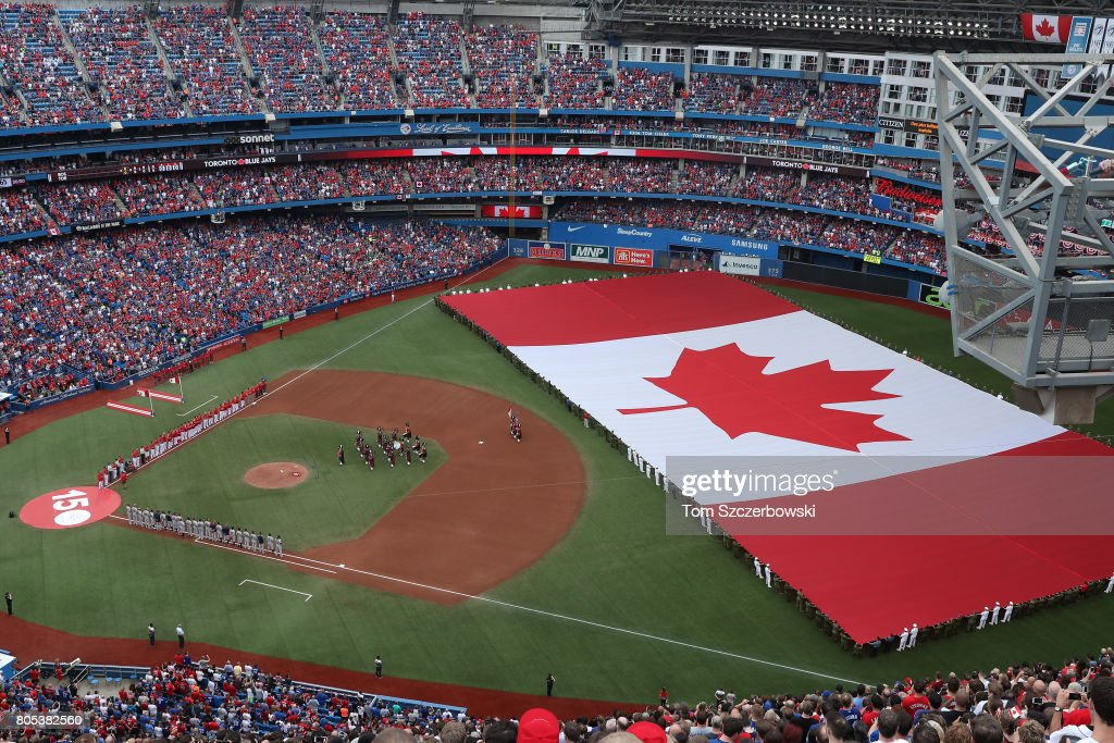 A general view of Rogers Centre as a large Canadian flag is unfurled in the outfield on Canada Day during the playing of the Canadian national anthem before the start of the Toronto Blue Jays MLB game against the Boston Red Sox at Rogers Centre on July 1, 2017 in Toronto, Canada.