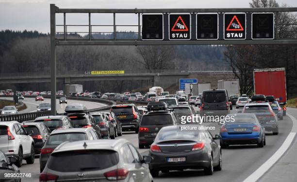 A general view of rows of cars moving slowly on the A8 motorway near Holzkirchen Germany 23 December 2017 Holiday traffic is jamming the streets...