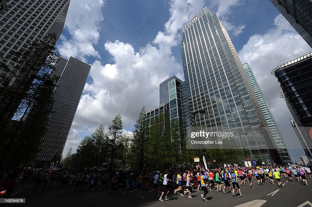 General view of Runners as they pass through Canary Wharf during the Virgin London Marathon 2012 on April 22, 2012 in London, England.