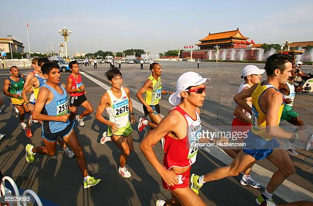 A general view of runners passing through Tianamen Square during the Men's Marathon held at the National Stadium during Day 16 of the Beijing 2008...