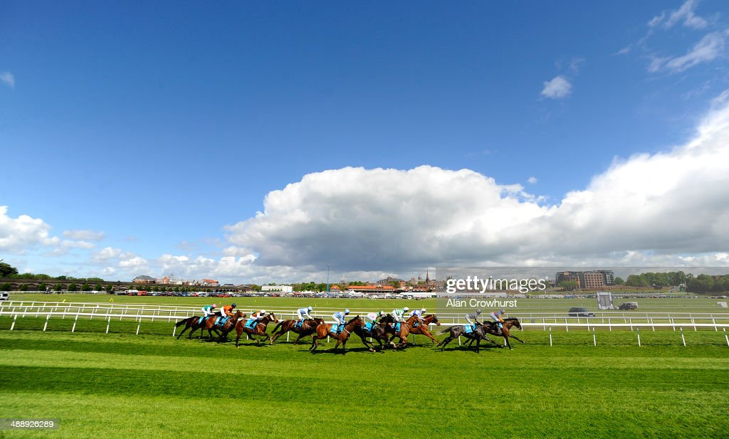 A general view of runners racing down the back straight at Chester racecourse on May 09, 2014 in Chester, England.