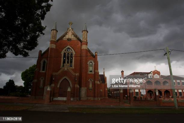 A general view of Saint Mary's Catholic Church as storm clouds roll across the central business area on March 17 2019 in Grafton Australia...