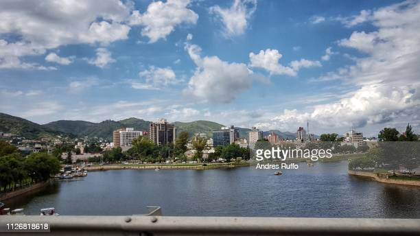 General view of San Roque Lake in the background city Villa Carlos Paz, Argentina