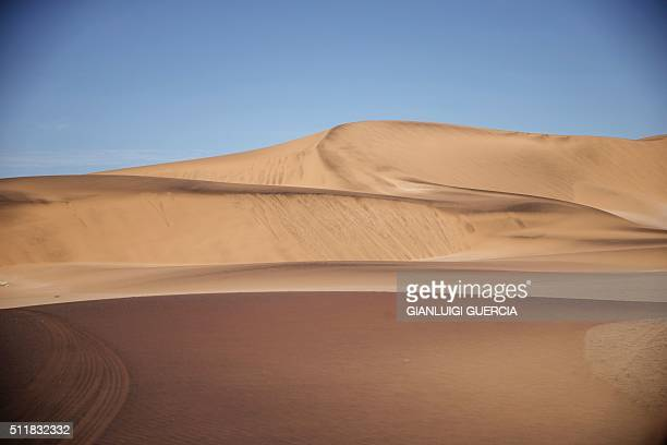 A general view of sand dunes and desert area of the Dorob National Park part of the Namib desert is taken on February 17 2016 on the outskirts of...