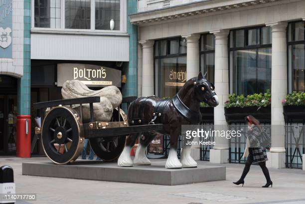 A general view of Sarah Lucas' sculpture Perceval a lifesize bronze horse and cart presenting a largescale replica of a traditional china ornament on...