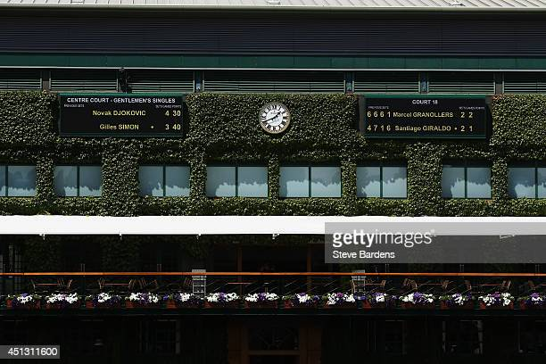A general view of scoreboards and the ivy on the outside of the centre court building on day five of the Wimbledon Lawn Tennis Championships at the...