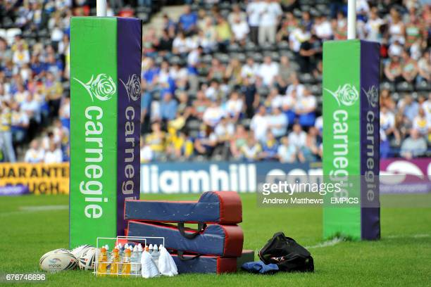 General view of scrummaging equipment and Gatorade drinks with some engage Steeden match balls lying next to a Carnegie branded post protector