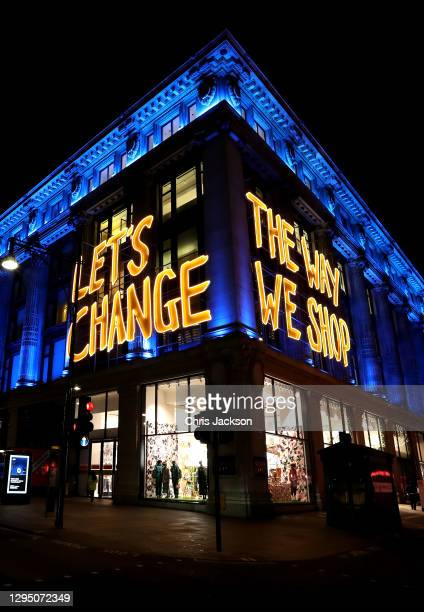 General view of Selfridges department store on Oxford Street as the skyline of London is lit up blue in support of the NHS on January 07, 2021 in...