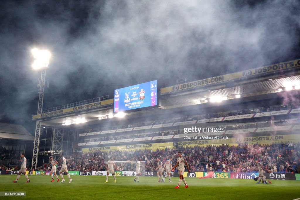 A general view (GV) of Selhurst Park as flare smoke from the 2nd Liverpool goal celebration drifts through the air during the Premier League match between Crystal Palace and Liverpool FC at Selhurst Park on August 20, 2018 in London, United Kingdom.