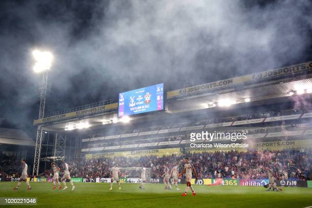 A general view of Selhurst Park as flare smoke from the 2nd Liverpool goal celebration drifts through the air during the Premier League match between...