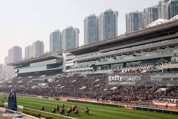 A general view of Sha Tin race course during a horse race at the Longines International Race Day in Hong Kong on December 10 2017 / AFP PHOTO / ISAAC...