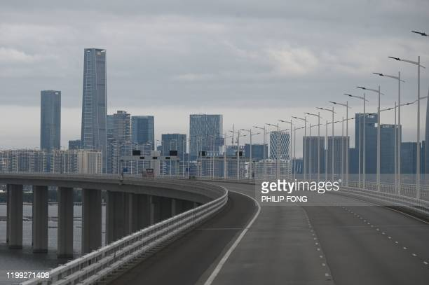 TOPSHOT A general view of Shenzhen is seen from a bus travelling on the Shenzhen Bay bridge in Hong Kong on February 8 2020 Hong Kong began enforcing...