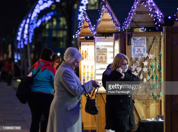 General view of shoppers browsing the Christmas Markets on November 30, 2020 in Cardiff, Wales.