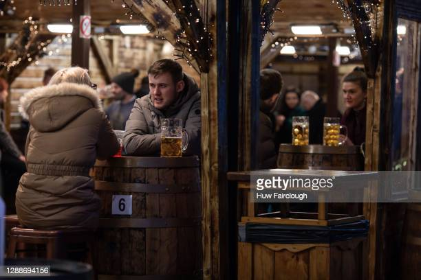 General view of shoppers enjoying a drink at the City Christmas Market on November 30, 2020 in Cardiff, Wales. The Welsh Government has announced...
