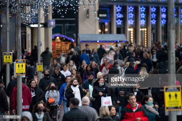 General view of shoppers on the Hayes on November 21, 2020 in Cardiff, Wales. Restrictions across Wales have been relaxed following a two-week...