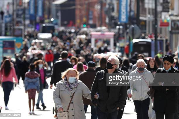 General view of shoppers wearing face masks on Briggate as non-essential retail reopens on April 12, 2021 in Leeds, United Kingdom. England has taken...