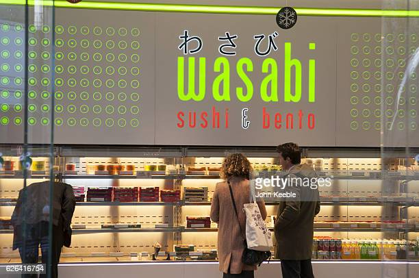A general view of signage of a Wasabi Sushi and Bento outlet on Fenchurch Street on November 22 2016 in London United Kingdom
