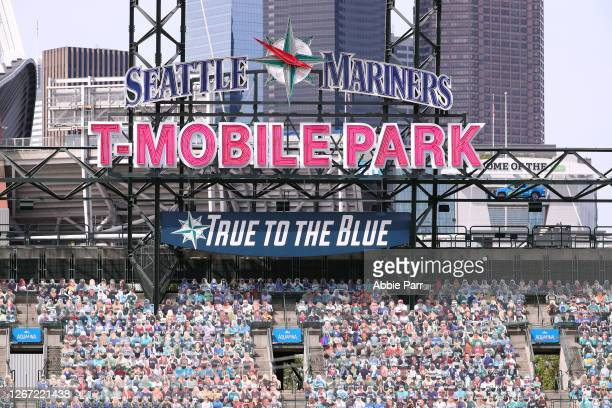 """General view of signage surrounded by the Seattle Mariners' """"seat fleet"""" of cutout fans at T-Mobile Park on August 19, 2020 in Seattle, Washington."""