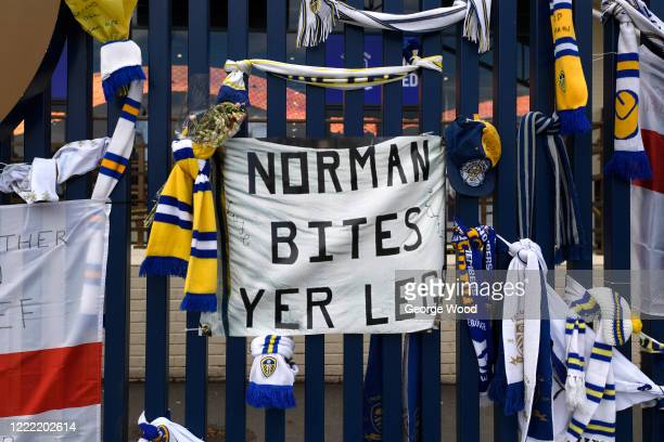 A general view of signs and scarves dedicated to former footballer Norman Hunter outside the Leeds United stadium Elland Road on May 01 2020 in Leeds...
