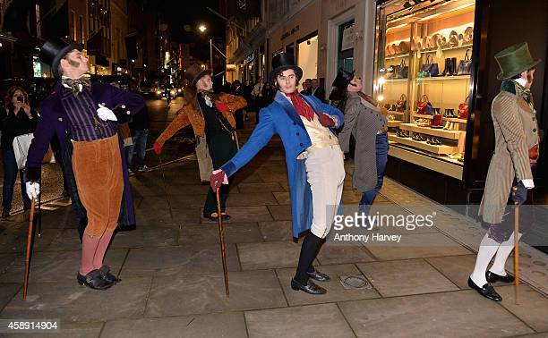 """General view of six dapper young men re-enacting the famous 18th century """"Bond Street Roll"""" in celebration of Bond Street's spectacular christmas..."""