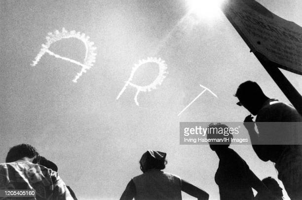 General view of sky writing with the word ART scene at the beach circa 1940's in East Hampton New York