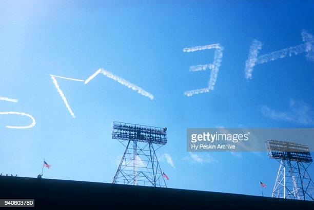 General view of skywriting is seen during a game in the 1953 World Series between the New York Yankees and Brooklyn Dodgers circa October 1953 at...